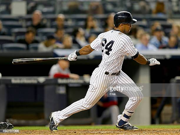 Chris Young of the New York Yankees hits an RBI single in the fifth inning against the Boston Red Sox on September 30 2015 at Yankee Stadium in the...