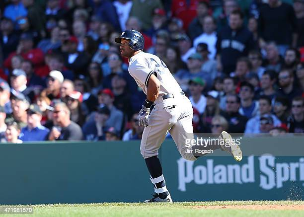 Chris Young of the New York Yankees watches his home run in the ninth inning against the Boston Red Soxat Fenway Park May 2 2015 in Boston...