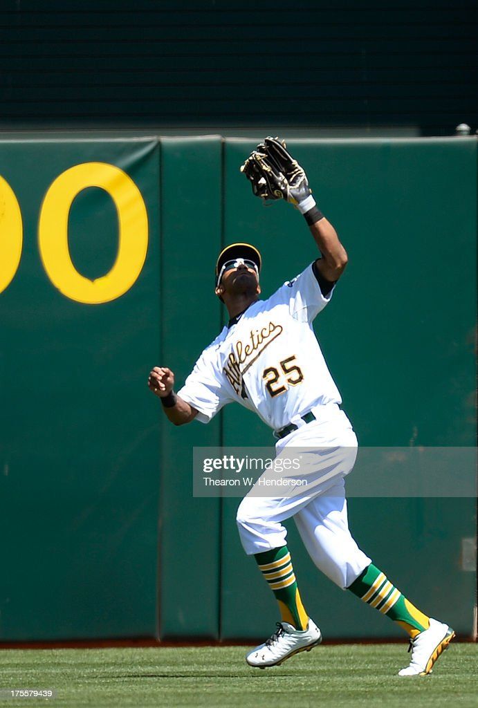 Chris Young #25 of the Oakland Athletics battled the sun to catch this fly ball off the bat of A.J. Pierzynski #12 of the Texas Rangers in the six inning at O.co Coliseum on August 4, 2013 in Oakland, California.