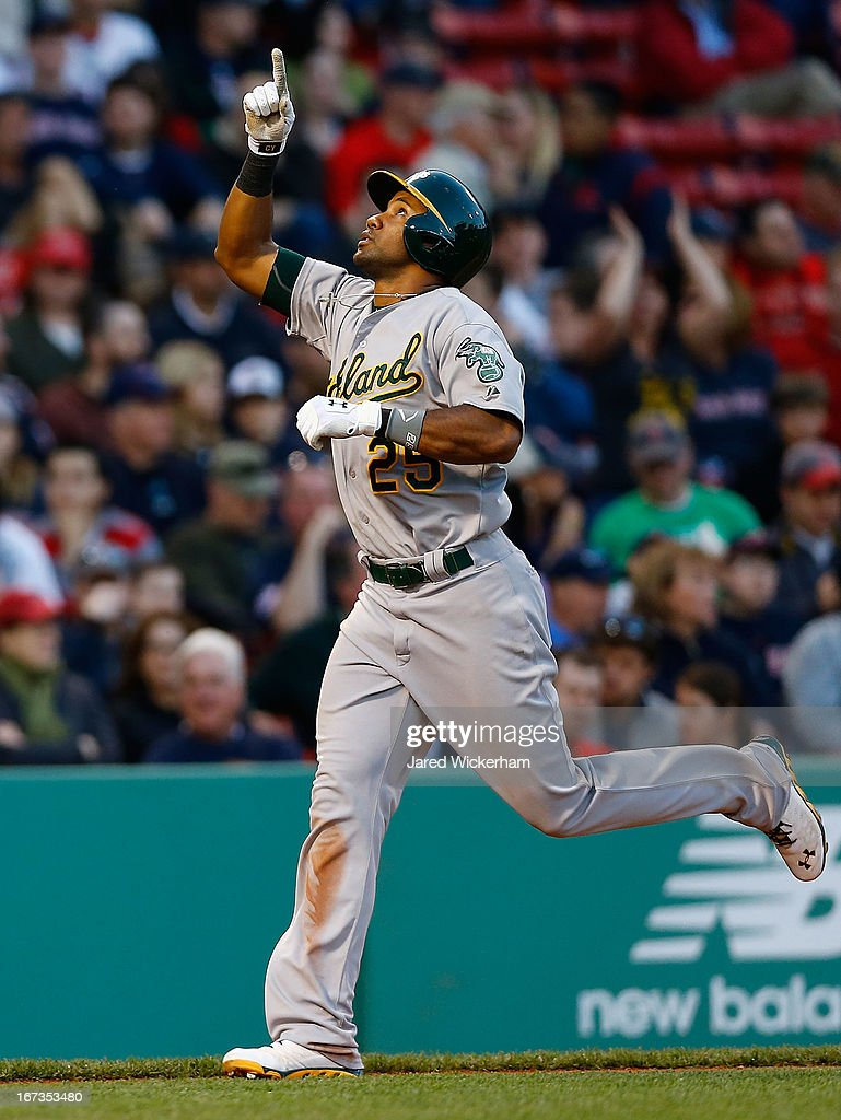 Chris Young #25 of the Oakland Athletics celebrates after hitting a solo home run in the eighth inning against the Boston Red Sox during the game on April 24, 2013 at Fenway Park in Boston, Massachusetts.