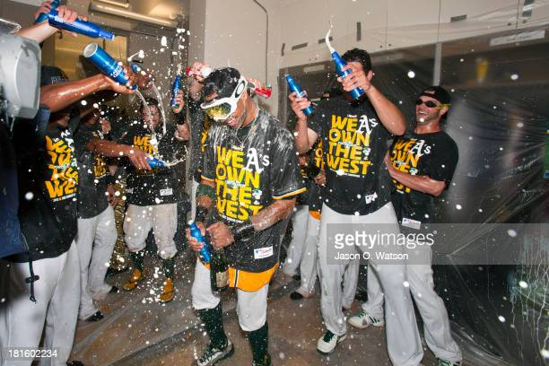 Chris Young of the Oakland Athletics celebrates with teammates in the clubhouse after the game against the Minnesota Twins at Oco Coliseum on...