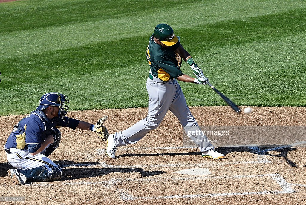 Chris Young #25 of the Oakland Athletics hits a single during the spring training game against the Milwaukee Brewersd at Maryvale Baseball Park on February 23, 2013 in Phoenix, Arizona.