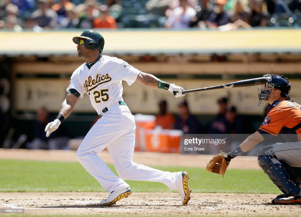 Chris Young #25 of the Oakland Athletics hits a single that scored John Jaso #5 in the first inning of their game against the Houston Astros at O.co Coliseum on April 17, 2013 in Oakland, California.