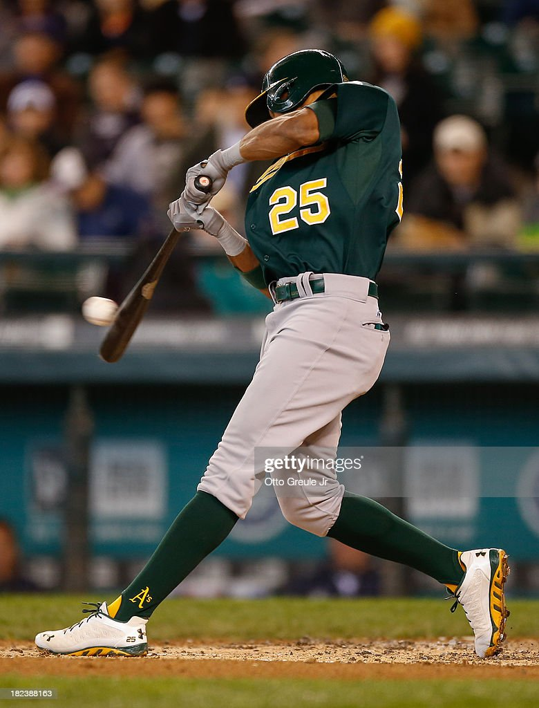 Chris Young #25 of the Oakland Athletics hits a two run RBI single in the second inning against the Seattle Mariners at Safeco Field on September 29, 2013 in Seattle, Washington.