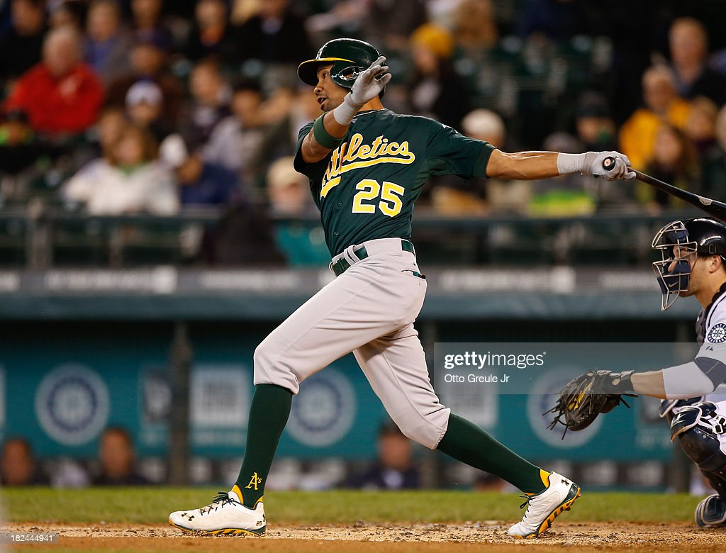 Chris Young #25 of the Oakland Athletics hits a two run RBI single in the second inning against the Seattle Mariners at Safeco Field on September 29, 2013 in Seattle, Washington. The Athletics defeated the Mariners 9-0.