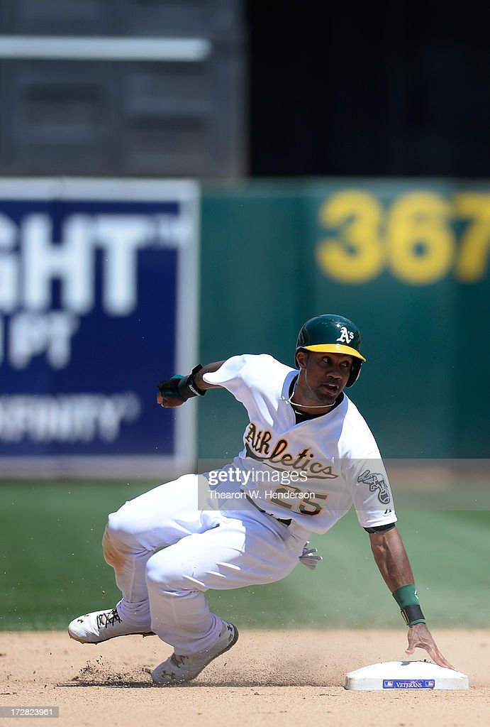 Chris Young #25 of the Oakland Athletics holds onto second base but was called out, caught stealing against the Chicago Cubs in the seventh inning at O.co Coliseum on July 4, 2013 in Oakland, California.