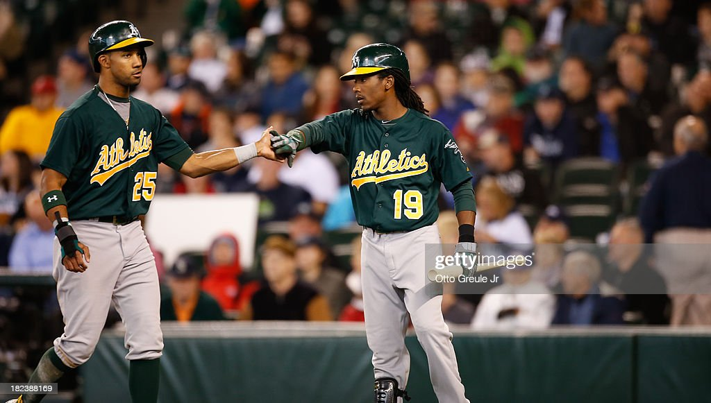 Chris Young #25 of the Oakland Athletics is congratulated by <a gi-track='captionPersonalityLinkClicked' href=/galleries/search?phrase=Jemile+Weeks&family=editorial&specificpeople=4583261 ng-click='$event.stopPropagation()'>Jemile Weeks</a> #19 after scoring on a double by Seth Smith in the second inning against the Seattle Mariners at Safeco Field on September 29, 2013 in Seattle, Washington.