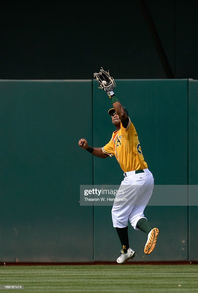Chris Young #25 of the Oakland Athletics leaps to take a hit away from Hector Gimenez #38 of the Chicago White Sox in the ninth inning at O.co Coliseum on June 1, 2013 in Oakland, California.
