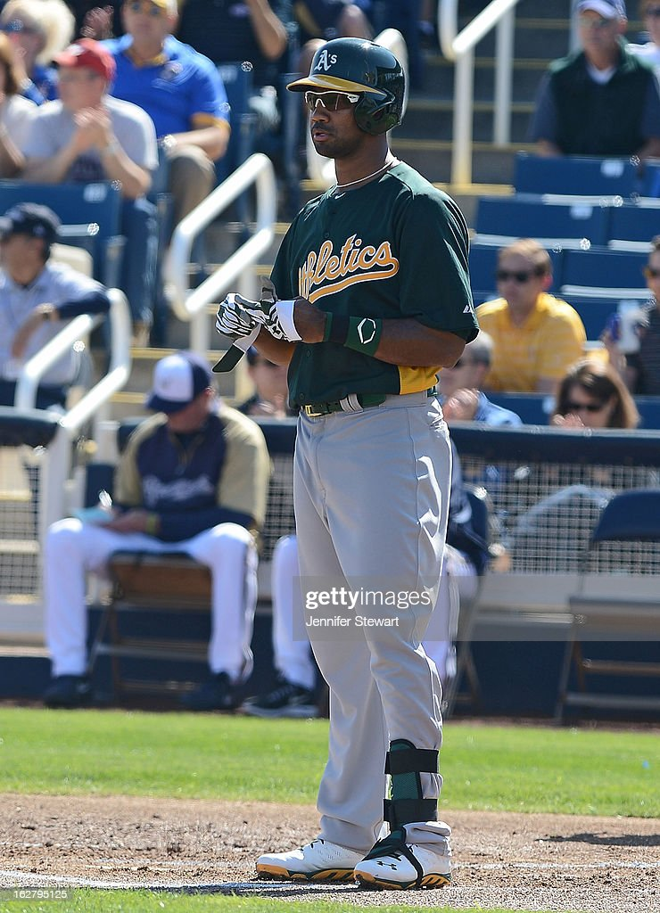 Chris Young #25 of the Oakland Athletics reacts after striking out in the spring training game against the Milwaukee Brewers at Maryvale Baseball Park on February 23, 2013 in Phoenix, Arizona.