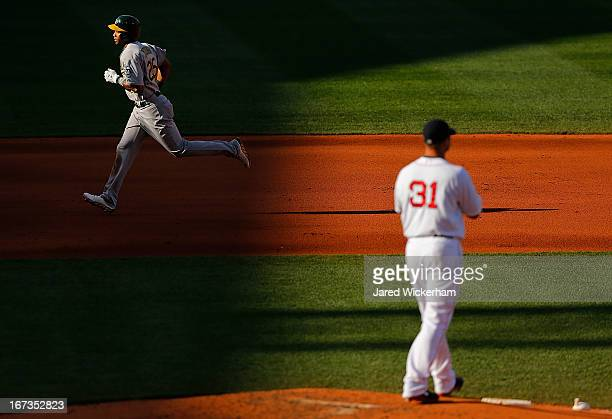Chris Young of the Oakland Athletics trots around second base after hitting a threerun home run in the fourth inning off of Jon Lester of the Boston...