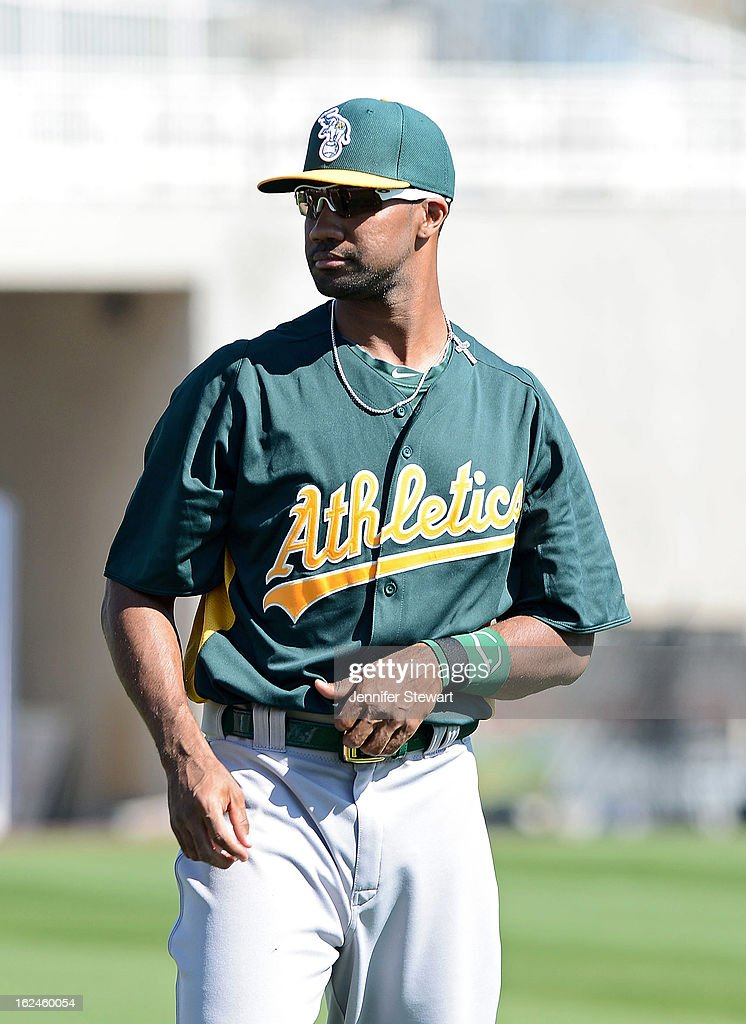 Chris Young #25 of the Oakland Athletics warms up prior to the spring training game against the Milwaukee Brewers at Maryvale Baseball Park on February 23, 2013 in Phoenix, Arizona.