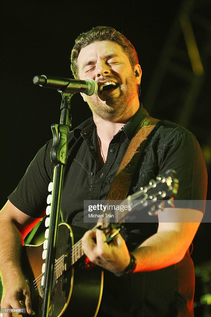 Chris Young performs onstage during the 'Beat This Summer Tour' held at San Manuel Amphitheater on August 24 2013 in San Bernardino California