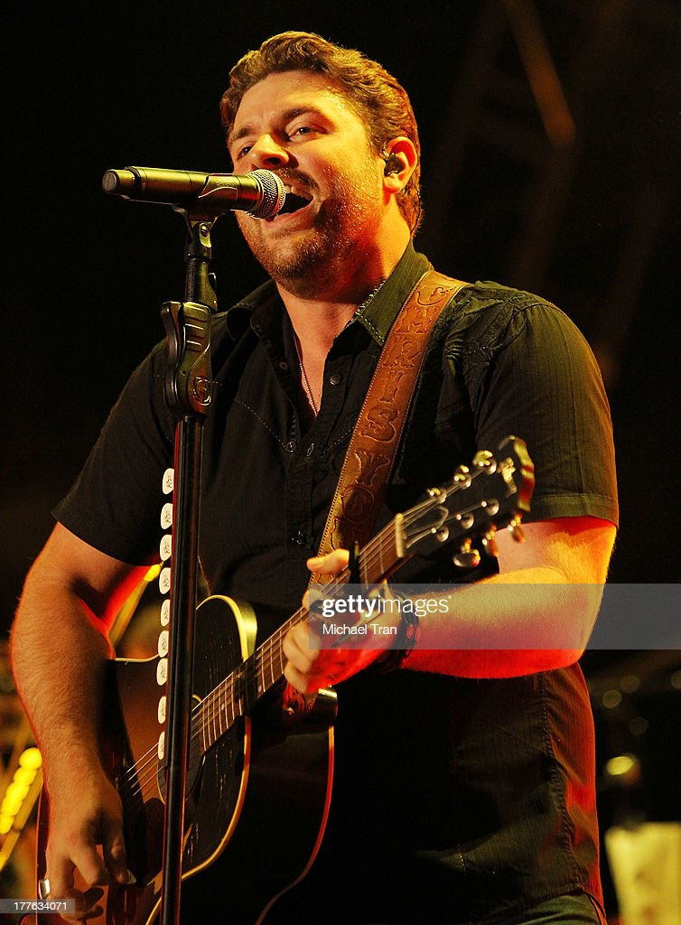 Chris Young performs onstage during the 'Beat This Summer Tour' held at San Manuel Amphitheater on August 24, 2013 in San Bernardino, California.