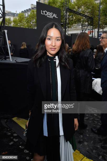 Chriselle Lim attends Le Defile L'Oreal Paris as part of Paris Fashion Week Womenswear Spring/Summer 2018 at Avenue Des Champs Elysees on October 1...