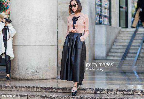 Chriselle Lim wearing a black Rochas leather skirt platform sandals and a blouse outside Rochas during the Paris Fashion Week Womenswear Fall/Winter...