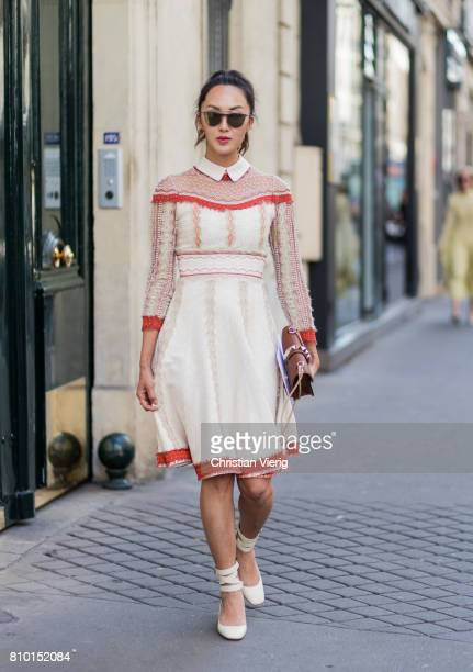 Chriselle Lim wearing a creme red dress Valentino bag outside Valentino during Paris Fashion Week Haute Couture Fall/Winter 20172018 Day Four on July...