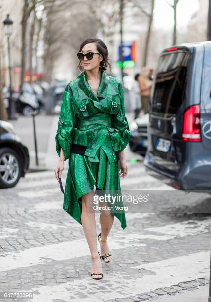 Chriselle Lim wearing a green coat and skirt outside Balmain on March 2 2017 in Paris France