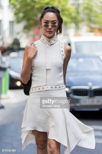 Chriselle Lim wearing a white dress outside Elie Saab during Paris Fashion Week Haute Couture Fall/Winter 20172018 Day Four on July 5 2017 in Paris...