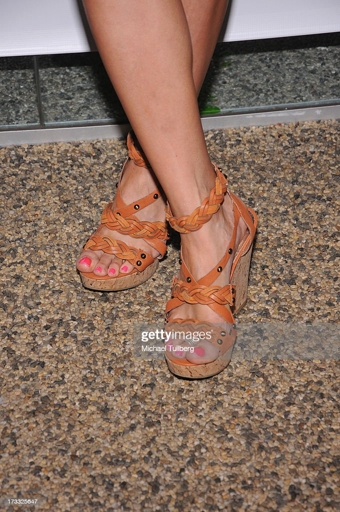 <a gi-track='captionPersonalityLinkClicked' href=/galleries/search?phrase=Chrishell+Stause&family=editorial&specificpeople=675283 ng-click='$event.stopPropagation()'>Chrishell Stause</a> (shoe detail) at the Gents At Kitson Launch Event at Kitson on Roberston on July 11, 2013 in Beverly Hills, California.