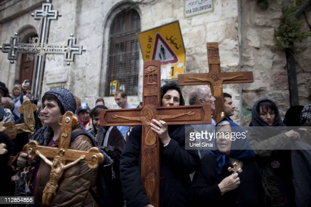 Chrisitan pilgrims carry wooden crosses along the Via Dolorosa during the Good Friday procession on April 22 2011 in Jerusalem Israel Thousands of...