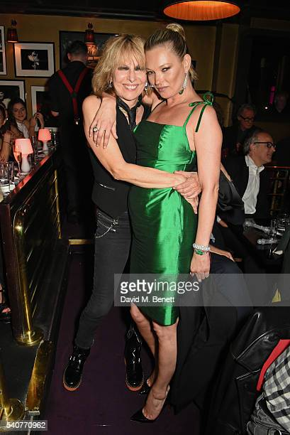 Chrissie Hynde and Kate Moss pose following their performance of 'Stand By Your Man' at 'Hoping's Greatest Hits' the 10th anniversary of The Hoping...