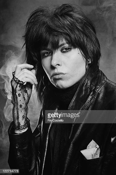 Chrissie Hynde US singer and guitarist with rock band The Pretenders wearing black lace fingerless gloves and a black leather jacket in a studio...