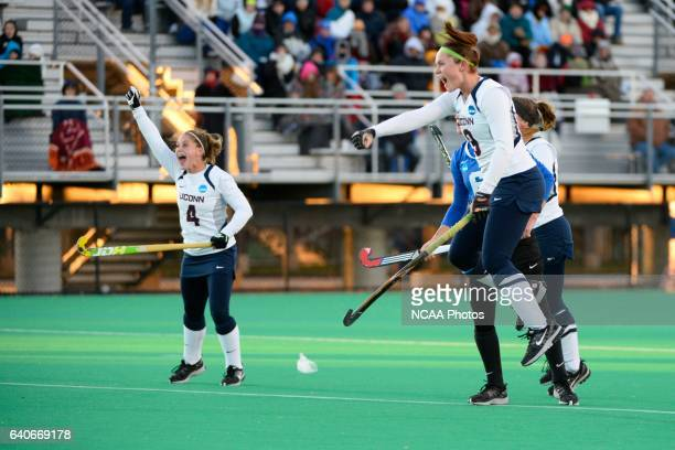 Chrissy Davidson and Chloe Hunnable of the University of Connecticut celebrate a goal against Duke University during the 2013 NCAA Women's Division I...