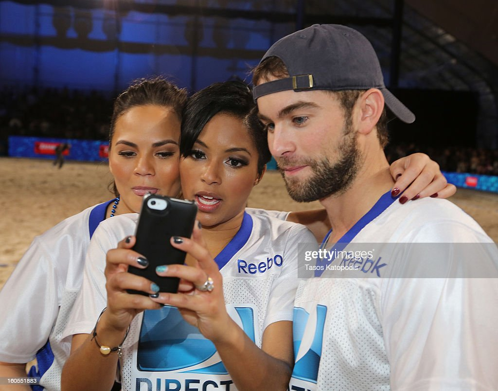 Chrissy Teigen, Alicia Quarles, and Chase Crawford attend DIRECTV'S Seventh Annual Celebrity Beach Bowl at DTV SuperFan Stadium at Mardi Gras World on February 2, 2013 in New Orleans, Louisiana.