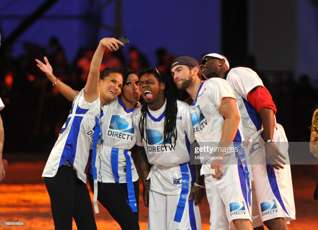 Chrissy Teigen, Alicia Quarles, Lil Wayne, and Chace Crawford, Deion Sanders attends DIRECTV'S Seventh Annual Celebrity Beach Bowl at DTV SuperFan Stadium at Mardi Gras World on February 2, 2013 in New Orleans, Louisiana.