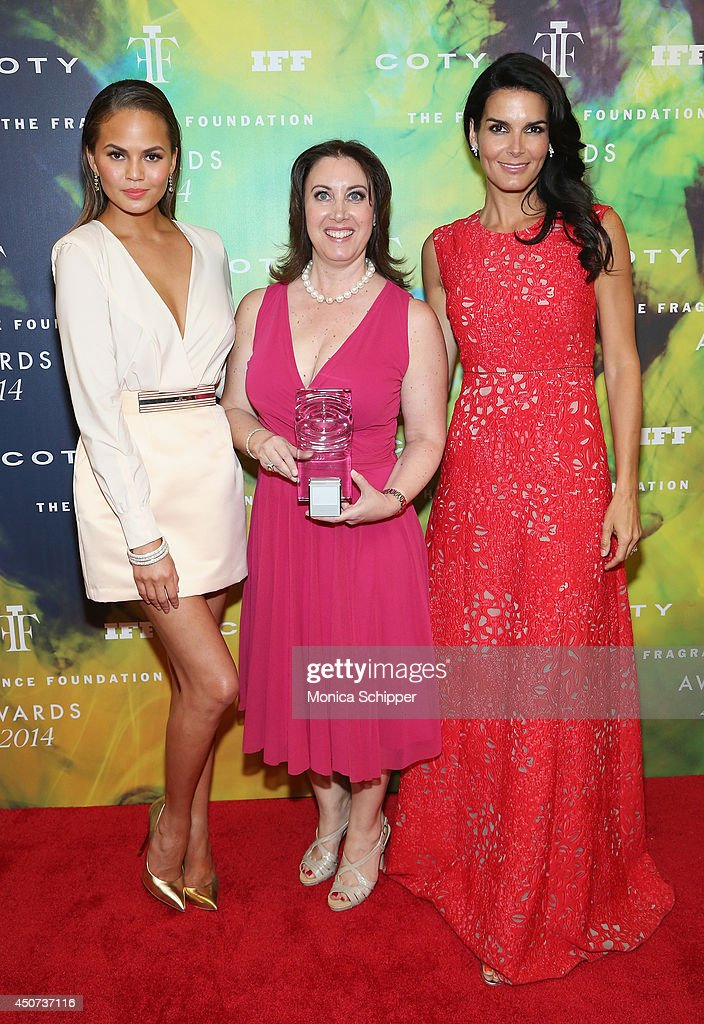Chrissy Teigen (L) and <a gi-track='captionPersonalityLinkClicked' href=/galleries/search?phrase=Angie+Harmon&family=editorial&specificpeople=204576 ng-click='$event.stopPropagation()'>Angie Harmon</a> (R) pose with Tamara Steele, Senior Vice President of Marketing at Elizabeth Arden, Inc. at the 2014 Fragrance Foundation Awards on June 16, 2014 in New York City.