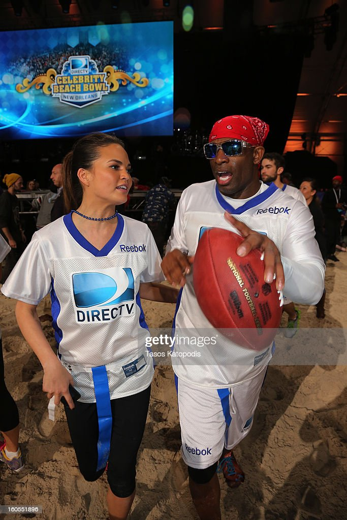 Chrissy Teigen and Deion Sanders attend DIRECTV'S Seventh Annual Celebrity Beach Bowl at DTV SuperFan Stadium at Mardi Gras World on February 2, 2013 in New Orleans, Louisiana.