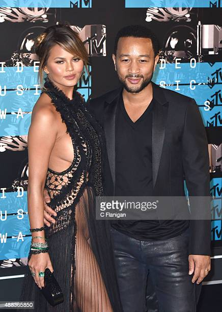 Chrissy Teigen and Johgn Legend arrives to the 2015 MTV Video Music Awards at Microsoft Theater on August 30 2015 in Los Angeles California
