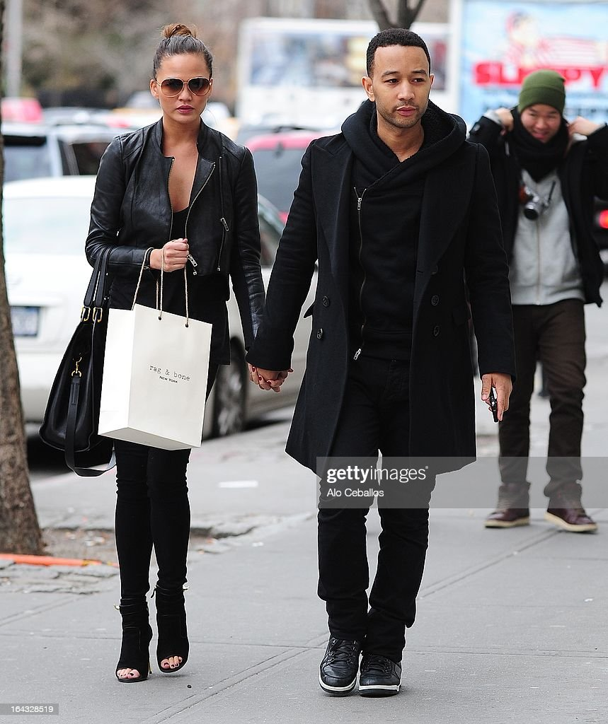 Chrissy Teigen and <a gi-track='captionPersonalityLinkClicked' href=/galleries/search?phrase=John+Legend&family=editorial&specificpeople=201468 ng-click='$event.stopPropagation()'>John Legend</a> are seen in the East Village on March 22, 2013 in New York City.
