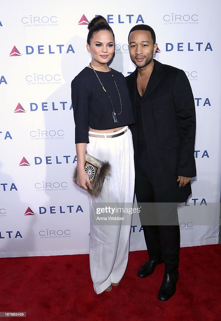 Chrissy Teigen, and <a gi-track='captionPersonalityLinkClicked' href=/galleries/search?phrase=John+Legend&family=editorial&specificpeople=201468 ng-click='$event.stopPropagation()'>John Legend</a> attend as Delta Air Lines celebrate the opening night of T4X, a pop up experience showcasing distinctive features of the airline's newly transformed international hub at JFK's Terminal 4 on May 1, 2013 in New York City.