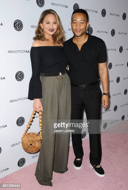 Chrissy Teigen and John Legend attend the 5th annual Beautycon festival at Los Angeles Convention Center on August 13 2017 in Los Angeles California