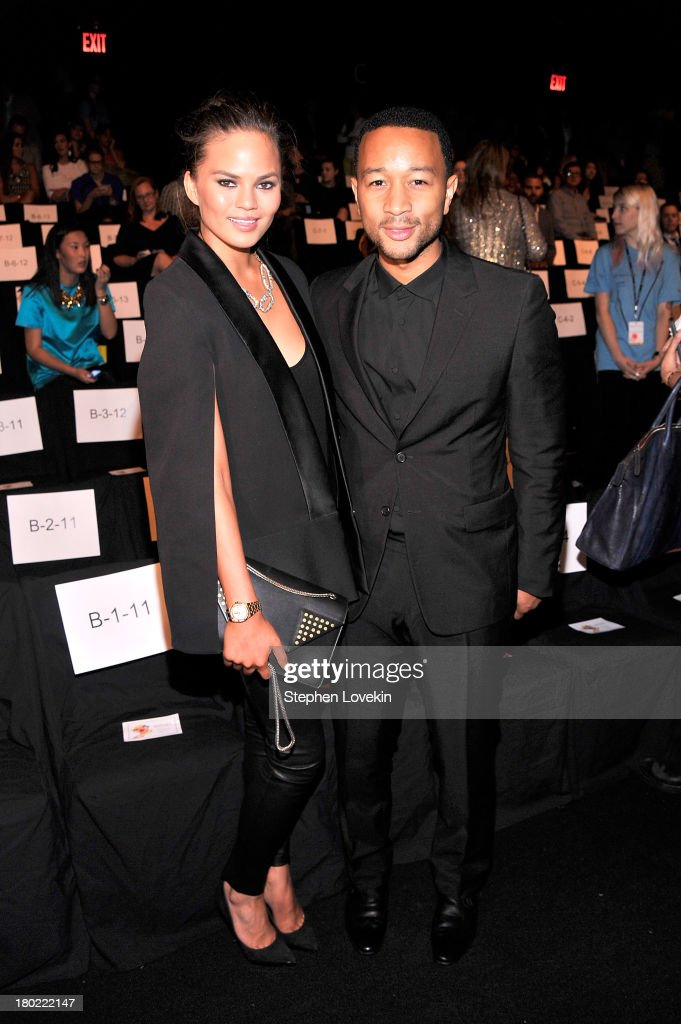 Chrissy Teigen (L) and <a gi-track='captionPersonalityLinkClicked' href=/galleries/search?phrase=John+Legend&family=editorial&specificpeople=201468 ng-click='$event.stopPropagation()'>John Legend</a> attend the Badgley Mischka fashion show during Mercedes-Benz Fashion Week Spring at The Theatre at Lincoln Center on September 10, 2013 in New York City.