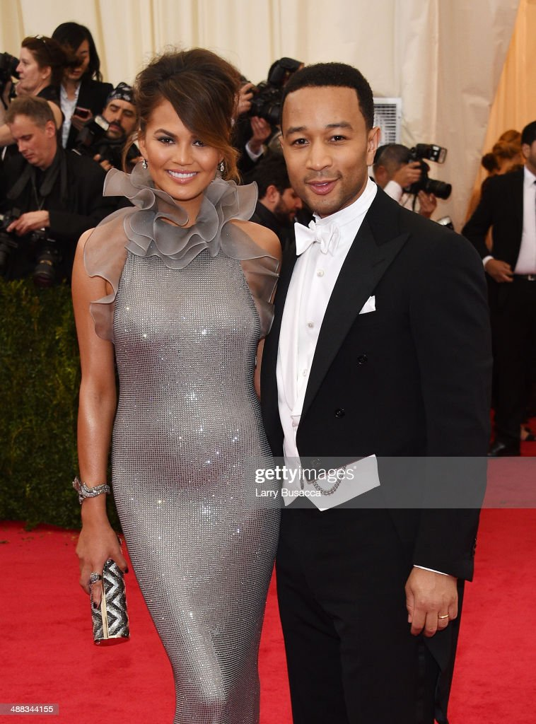 Chrissy Teigen (L) and John Legend attend the 'Charles James: Beyond Fashion' Costume Institute Gala at the Metropolitan Museum of Art on May 5, 2014 in New York City.