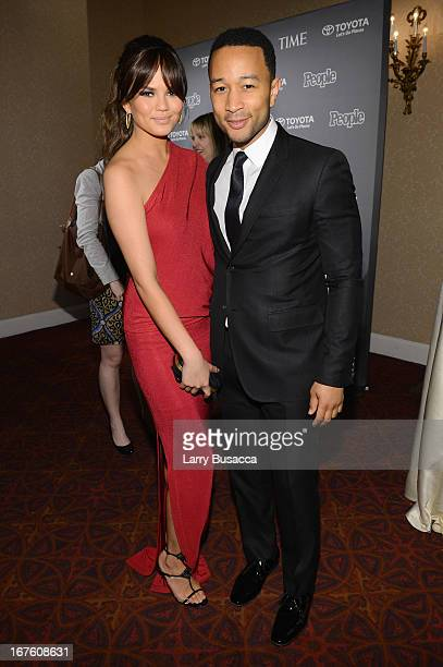 Chrissy Teigen and John Legend attend the PEOPLE/TIME Party On The Eve Of The White House Correspondents' Dinner on April 26 2013 in Washington DC