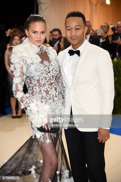 Chrissy Teigen and John Legend attend the 'Rei Kawakubo/Comme des Garcons Art Of The InBetween' Costume Institute Gala at Metropolitan Museum of Art...