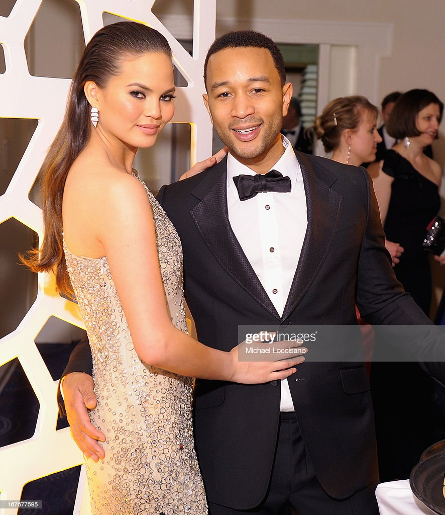 Chrissy Teigen and John Legend attend the TIME/CNN/PEOPLE/FORTUNE Pre-Dinner Cocktail Reception at Washington Hilton on April 27, 2013 in Washington, DC.