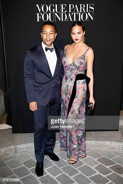 Chrissy Teigen and John Legend attend the Vogue Paris Foundation Gala at Palais Galliera on July 6 2015 in Paris France