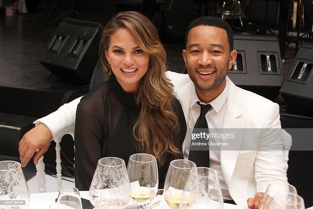 Chrissy Teigen and <a gi-track='captionPersonalityLinkClicked' href=/galleries/search?phrase=John+Legend&family=editorial&specificpeople=201468 ng-click='$event.stopPropagation()'>John Legend</a> attend the White Party Dinner Hosted by Andrea and Veronica Bocelli Celebrating Celebrity Fight Night In Italy Benefitting The Andrea Bocelli Foundation and The Muhammad Ali Parkinson Center on September 5, 2014 at the Bocelli Residence in Forte dei Marme, Italy.