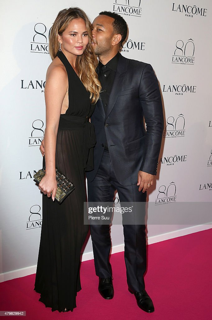 Chrissy Teigen and John Legend attends the Lancome 80th Anniversary Party as part of Paris Fashion Week Haute Couture Fall/Winter 2015/2016 on July 7, 2015 in Paris, France.