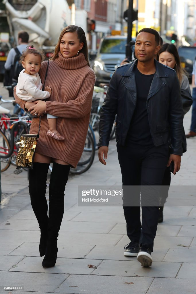 Chrissy Teigen and John Legend seen leaving an office building with their daughter Luna on September 13, 2017 in London, England.