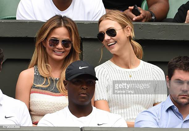 Chrissy Teigen and Karlie Kloss attend day seven of the Wimbledon Tennis Championships at Wimbledon on July 6 2015 in London England