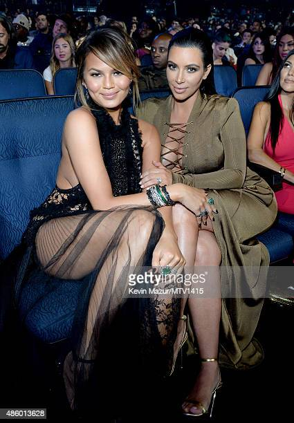 Chrissy Teigen and Kim Kardashian West attend the 2015 MTV Video Music Awards at Microsoft Theater on August 30 2015 in Los Angeles California