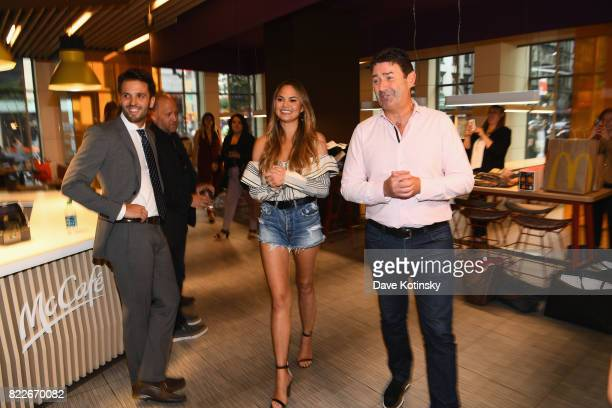 Chrissy Teigen and McDonald's CEO Steve Easterbrook visit McDonald's to celebrate McDelivery on July 25 2017 in New York City