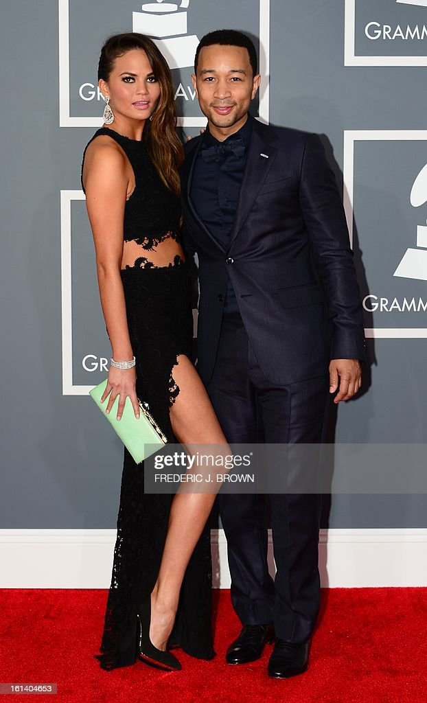 Chrissy Teigen and musician John Legend arrive on the red carpet at the Staples Center for the 55th Grammy Awards in Los Angeles, California, February 10, 2013. AFP PHOTO Frederic J. BROWN