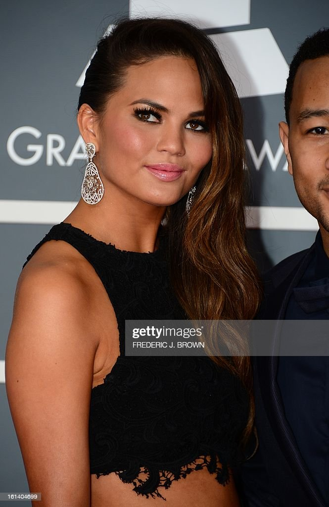 Chrissy Teigen (L) and musician John Legend arrive on the red carpet at the Staples Center for the 55th Grammy Awards in Los Angeles, California, February 10, 2013. AFP PHOTO Frederic J. BROWN