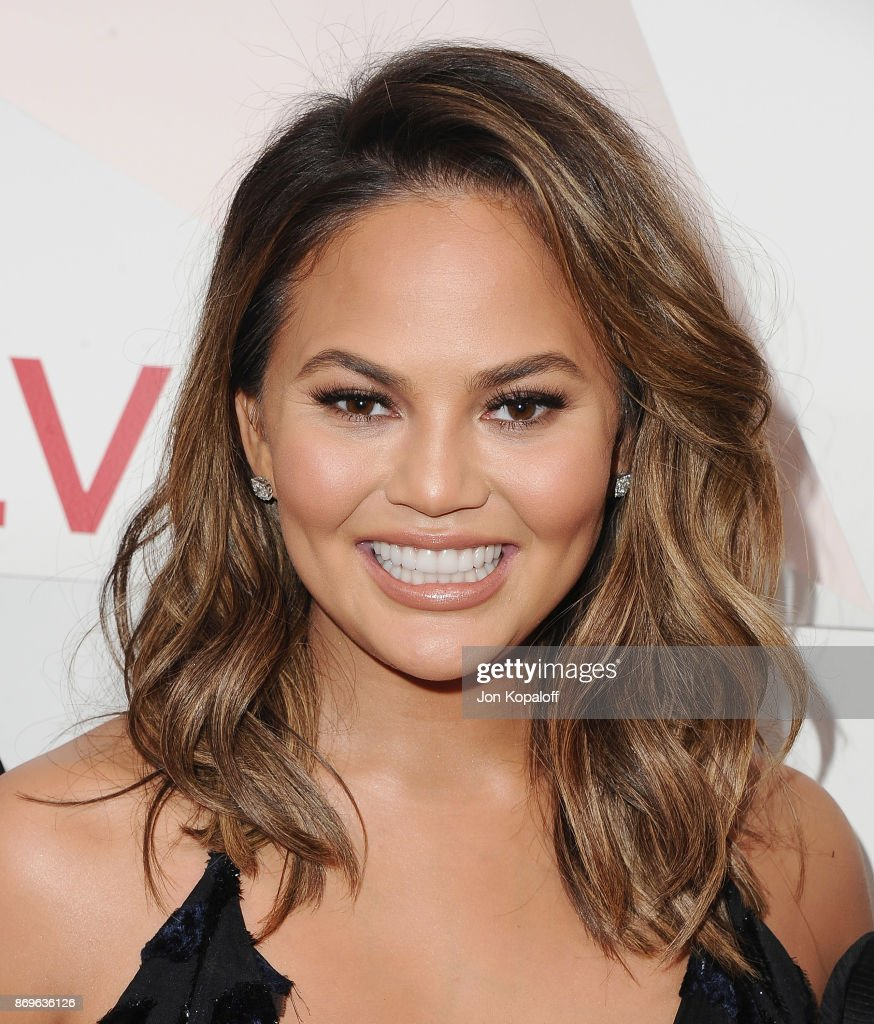 Chrissy Teigen arrives at #REVOLVEawards at DREAM Hollywood on November 2, 2017 in Hollywood, California.